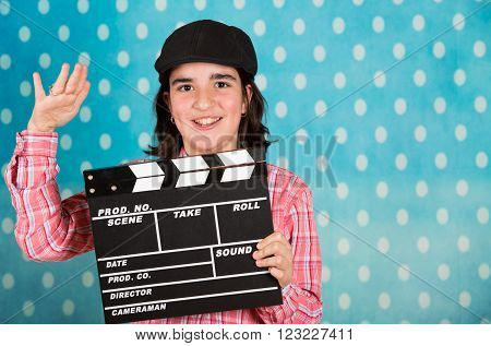 Teen girl with a clapperboard film playing the film director