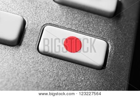 Macro Of A Record Button On Chrome Remote Control For A Hifi Stereo Audio System