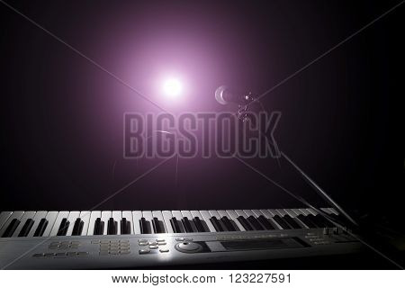 Microphone  And Piano In Dark Background