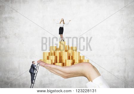 Businessman on ladder trying to reach hand with golden coins businesswoman on top. Concrete background. Concept of career growth.