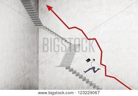 Businessman with case running up steep stairs red graph along it. Concrete background. Concept of career growth.