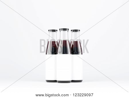 Three wine bottles with wide neck blank labels on them. White glass. Concept of bottling wine. Mock up. 3D rendering.