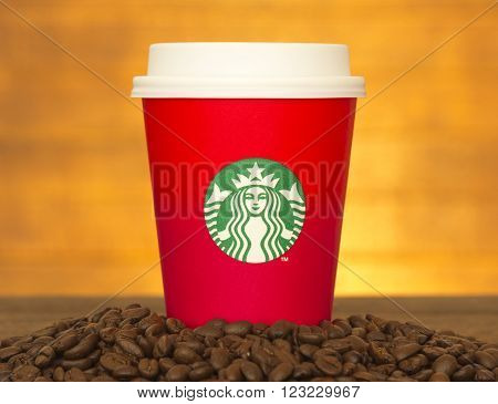 Bangkok Thailand - November 10 2015: The new paper cup of Starbucks stores in the country for the Christmas on a red background cup of Starbucks logo. Starbucks brand is one of the world famous coffeehouse chains from USA.