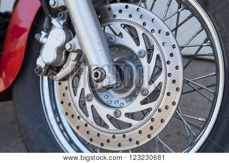 close up disk brake system on a motorcycle