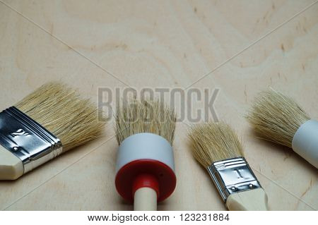four different brush lying in semicircular on the table