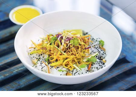 curry sauce vegetable salad with noodles and sesame modern asian fusion dish
