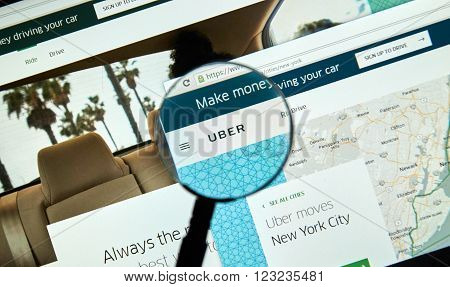 MONTREAL CANADA - MARCH 25 2016 - Uber online service under magnifying glass. Uber Technologies Inc. is an American multinational online transportation network.