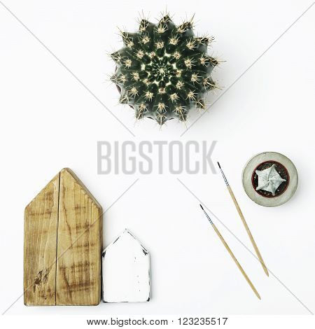 Mock up. Hipster scandinavian home interior decoration. Wooden houses with cactus and succulent and place for text.
