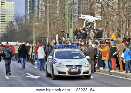 BRUSSELS BELGIUM - JANUARY 11 2015: A drone flying over the Brussels event against terrorism and support for freedom of expression after the attacks against the magazine Charlie hebdo