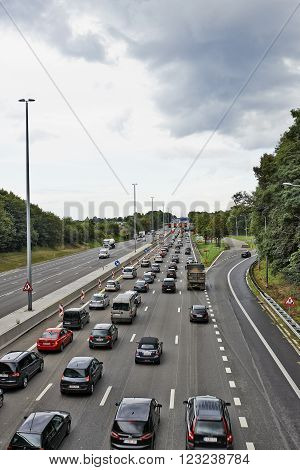 BERTEM BELGIUM - AUGUST 12 2014: Picture shows lots of car stucked in Bertem cloverleaf on the highway E40 as works in august 2014