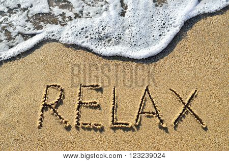 Sea Surf And The Word Relax On The Sand