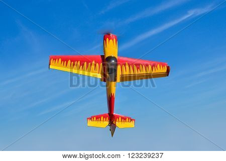Flying the plane performs aerobatics in the sky