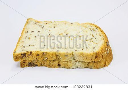 Multigrain wholegrain bread Loaf sliced on white background