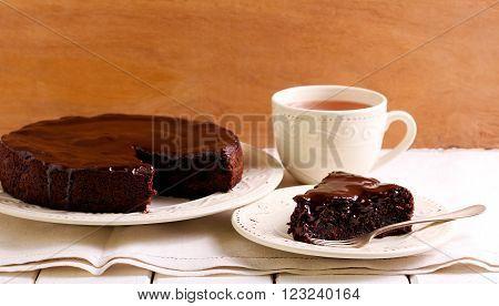 Chocolate and cherry cake under chocolate glaze