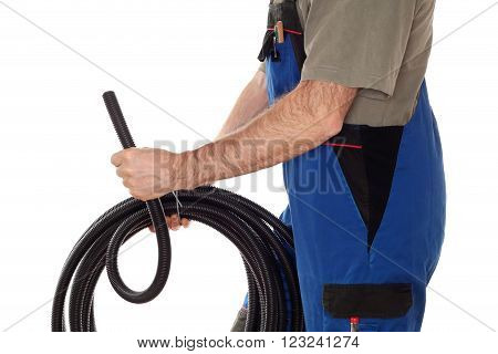 electrician worker with black pipe in hands