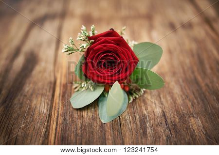 The bridal boutonniere on the wooden background