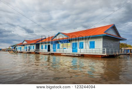 SIEM REAP, CAMBODIA DEC. 16: Cambodian people live on Tonle Sap Lake in Siem Reap, Cambodia on December 16, 2011. School on the water.