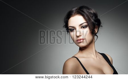 Fashion Brunette Girl. Profile portrait of a beautiful  woman on dark background. Luxury woman. Concept of beauty and fashion.