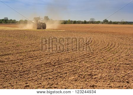 Cultivator Operates On Ploughed Field Raises Dust
