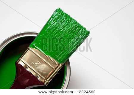 paintbrush on a green paint