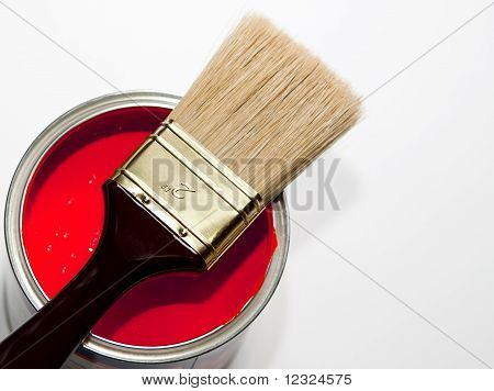 paintbrush on red paint can