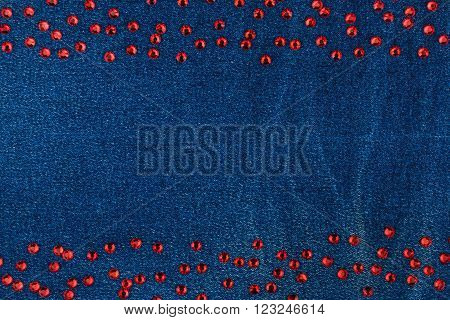 Fashionable background denim and red rhinestones with space for your text