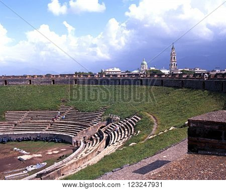 POMPEI, ITALY - SEPTEMBER 21, 1996 - Elevated view of the Roman Theatre ruin with modern buildings to the rear Pompeii Campania Italy Europe, September 21, 1996.