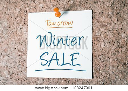 Winter Sale Reminder For Tomorrow On Paper Pinned On Cork Board