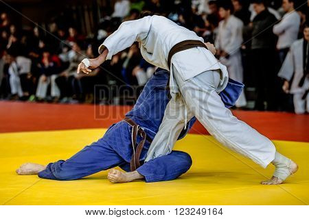 Chelyabinsk, Russia -  March 19, 2016: fighters judoists fight in time to compete in judo on a tatami in Russian competition on judo