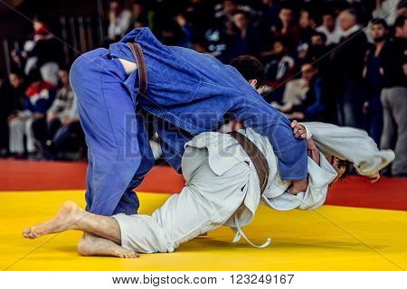 Chelyabinsk, Russia -  March 19, 2016: fighters judoists background fans in Russian competition on judo