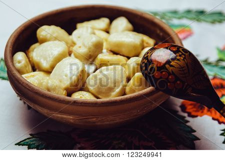 Beautiful Hot Dumplings With Sour Cream And Fried Onions In A Clay Bowl With A Wooden Spoon Are Embr