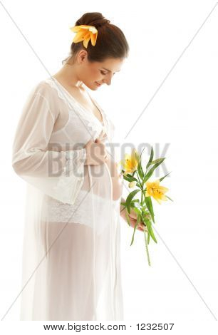 Beautiful Pregnant Woman With Yellow Lily