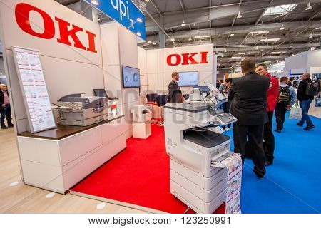 HANNOVER GERMANY - MARCH 15 2016: Booth of OKI company at CeBIT information technology trade show in Hannover Germany on March 15 2016.