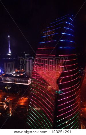 View of one of the Flame Towers from the Royal Suite in Baku, capital of Azerbaijan. A night view of Baku, showing part of the ultra-modern Flame Towers, taken from the highest room in a hotel in the Flame Towers