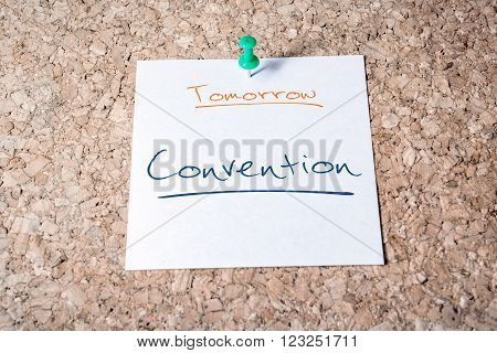 Convention Reminder For Tomorrow On Paper Pinned On Cork Board