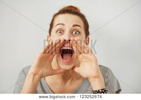Portrait Angry Woman Screaming, Wide Open Mouth, Hysterical Isolated Grey Wall Background. Negative