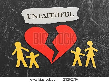 Paper family and broken red heart with Unfaithful message