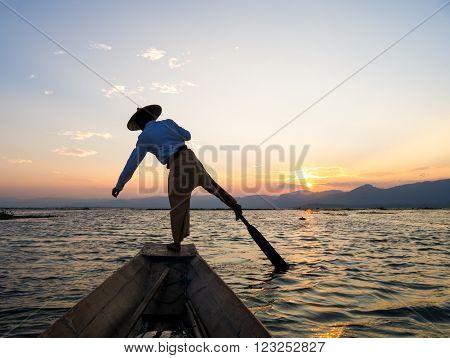 Silhouette fishermen in Inle Lake at sunrise Inle Shan State Myanmar