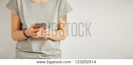 Beautiful Hipster Woman Checking Email Via Mobile Phone While Background With Copy Space For Text Me