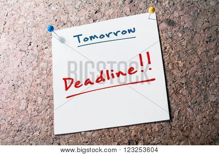 Deadline Reminder For Tomorrow On Paper Pinned On Cork Board