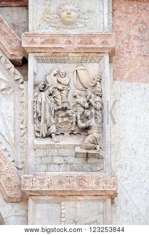 BOLOGNA, ITALY - JUNE 04: Jesus raised Lazarus by Casario, left door of San Petronio Basilica in Bologna, Italy, on June 04, 2015