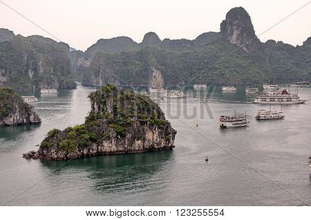 HALONG BAY, VIETNAM. 05 APRIL  2015.  Tourist Cruise boats  floats in the bay according to the standard sightseeing program.