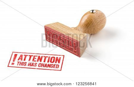 A Rubber Stamp On A White Background - Attention This Has Changed