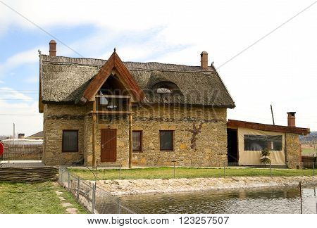 House made in old Moldavian style with thatched roof