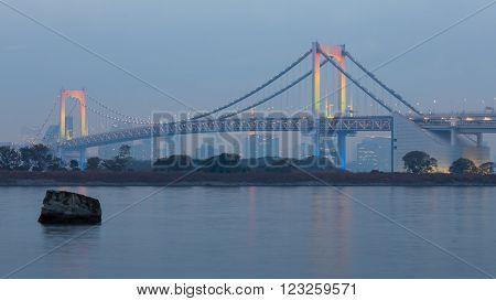 Odiaba Tokyo, Japan, Rainbow bridge at Tokyo Bay at dusk
