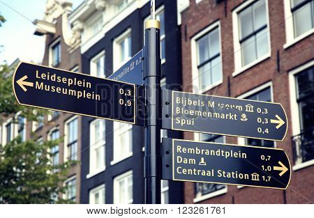AMSTERDAM; THE NETHERLANDS - AUGUST 19; 2015: Tourist signpost street indicating an interesting excursion in Amsterdam. Amsterdam is capital of the Netherlands on August 19; 2015.