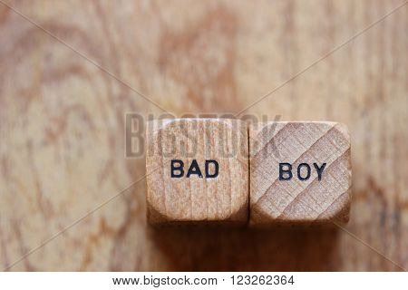 Bad boy printed on two wooden dice with room for copy