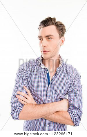 Portrait Of Serious Handsome Minded Man With Crossed Hands