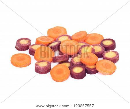 Sliced organic carrots separated on white background