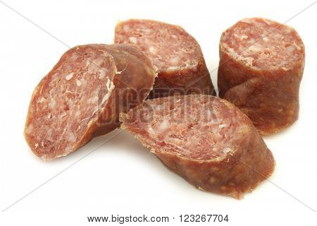 cut pieces of traditional frisian smoked and dried sausages on a white background
